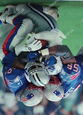 WILLIAMS MCGINEST BROWN Dallas Cowboys running back Sherman Williams (20) is tackled by New England Patriots defensive end Willie McGinest (55) and linebacker Monty Brown (93) in the first quarter, in Irving, Texas