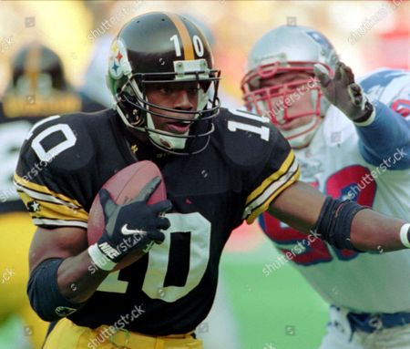 Stock Image of STEWART JOHNSON Pittsburgh Steelers rookie quarterback Kordell Stewart (10) is run out of bounds by New England Patriots linebacker Ted Johnson (52) in the second half of their game in Pittsburgh, . Stewart also rushed for a TD in the Steelers 41-27 victory