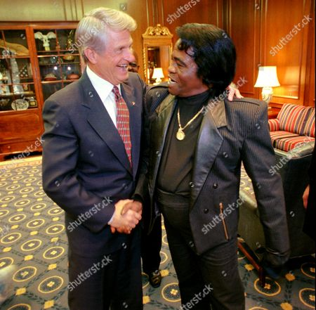 """Stock Picture of MILLER The """"Godfather of Soul"""" James Brown, right, shares a laugh with Georgia Gov. Zell Miller on at the Capitol in Atlanta. Brown, who was born in Augusta, Ga., was honored by both houses of the legislature during his visit"""