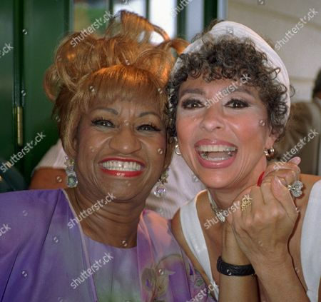 CRUZ Salsa singing queen Celia Cruz, left, and actress Rita Moreno pose for a photo at the opening celebration at four-time Grammy winner Tito Puente's new restaurant in New York
