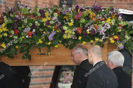 John Inman's coffin
