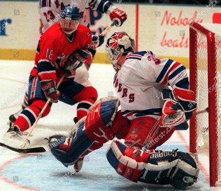 RICHTER BURE New York Rangers goalie Mike Richter stops a shot by Montreal Canadiens right wing Valeri Bure in the first period of their NHL playoff game in New York's Madison Square Garden