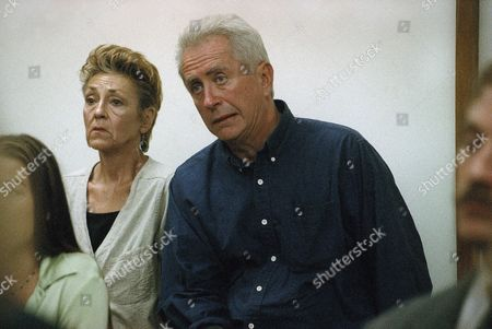 Robert Downey Sr. and an unidentified woman sit in the back row of the courtroom during a hearing for their son Robert Downey Jr. in Malibu, California Municipal Court on