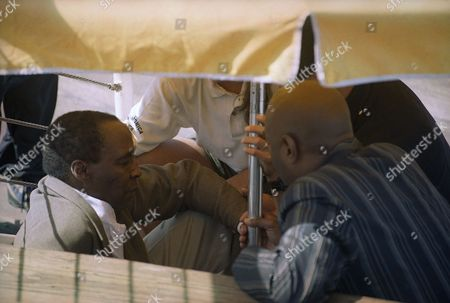 Actor Robert Guillaume is comforted by Santa Monica Pier police and a friend as they await paramedics on in Santa Monica, California. Guillaume slipped and injured his head prior to a memorial service on the pier for actress-model Margaux Hemingway, and then collapsed a second time during the services