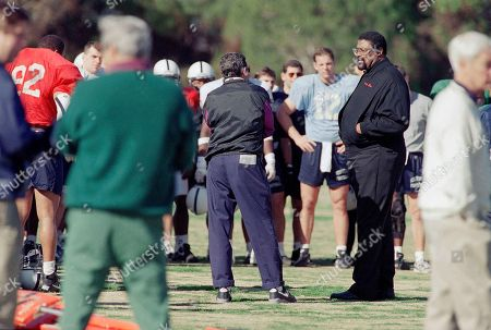 Rosey Grier, Joe Paterno, Kerry Collins Ex-NFL all-star Rosey Grier, right, talks to Penn State head football coach Joe Paterno, left, and his team, including quarterback Kerry Collins, (12), before practice in Irvine, Calif., in preparation for the next week's Rose Bowl game against the University of Oregon on January 2 in Pasadena, California