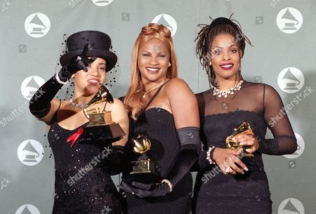 "JAMES DENTON ROPER Salt N' Pepa display the awards they won for Best Rap Duo or Group Performance for ""None of Your Business"" backstage at the 37th Annual Grammy Awards at the Shrine Auditorium in Los Angeles, Calif., on . From left are, Cheryl James, Sandy Denton and Dede Roper"