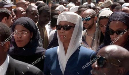 SHABAZZ Amidst other mourners, from left, sisters Malikah, Attallah, and Malaak arrive for the funeral of their mother Betty Shabazz at the Islamic Cutural Center of New York Mosque