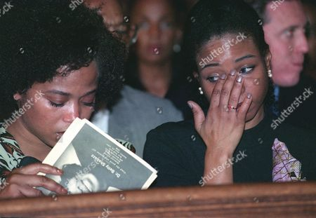 SHABAZZ Qubilah Shabazz, right, wipes away a tear while her sister, Malaak, looks down during a memorial service for their mother, Betty Shabazz, at Riverside Church in the Harlem section of New York . The widow of Malcolm X died last Monday, nearly a month after she was burned in a fire at her home. Among those attending the service were Gov. George Pataki, poet Maya Angelou and Coretta Scott King