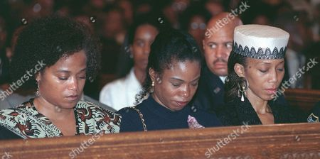 SHABAZZ Sisters Malaak Shabazz, left, Qubilah, center, and Attallah, bow their heads during a memorial service for their mother, Betty Shabazz, at Riverside Church in the Harlem section of New York . The widow of Malcolm X died last Monday, nearly a month after she was burned in a fire at her home. Among those attending the service were Gov. George Pataki, poet Maya Angelou and Coretta Scott King