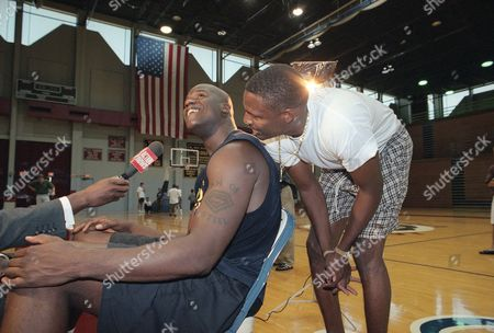 Shaquille O'Neal, Cedric Ceballos Newly-acquired Los Angeles Lakers center Shaquille O'Neal gets a visit from his new teammate Cedric Ceballos during a television interview following a short practice at Loyola Marymount University, in Los Angeles