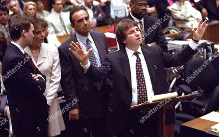Stock Picture of Scheck Shapiro Clark Darden Goldberg Defense attorney Barry Scheck, center, cross examines prosecution witness William Bodziak as, from left, Hank Goldberg, Marcia Clark, Robert Shapiro, and Christopher Darden, look on during the O.J. Simpson double-murder trial, in Los Angeles. The prosecution may finish rebutting the defense before the defense finished presenting the case prosecutors are rebutting