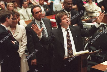 GOLDBERG Defense attorney Barry Scheck, center, cross examines prosecution witness William Bodziak as, from left, Hank Goldberg, Marcia Clark, Robert Shapiro, and Christopher Darden, look on during the O.J. Simpson double-murder trial, in Los Angeles. The prosecution may finish rebutting the defense before the defense finishes presenting the case prosecutors are rebutting