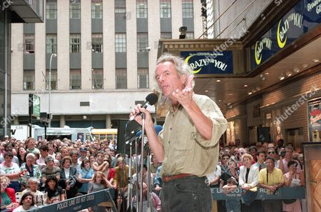 "Actor Spalding Gray performs to a lunchtime crowd in Shubert Alley in New York's theater district, as part of ""Stars in the Alley"" celebrating New York theater. Cast members from various plays performed numbers from their musicals free of charge as part of a week-long celebration sponsored by the League of American Theatres and Producers"