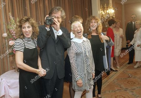 """Adler Spielberg Film director Steven Spielberg films photographers with a home video camera as he poses with his mother and three sisters at the Regent Beverly Wilshire Hotel in Beverly Hills, . His mother, Leah Adler, was honored as """"Mother of the Year"""" at the Helping Hand Annual Mother's Day Luncheon. From left to right: Nancy Spielberg, Spielberg, Adler, Sue Spielberg (partially obscured by Adler) and Anne Spielberg"""