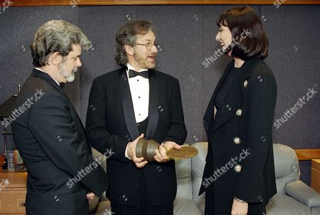 Stock Picture of Lucas Huston Spielberg Film director Steven Spielberg, center, talks with actress Anjelica Huston, and director George Lucas, about the weight of the John Huston Award that the three of them were to present to director Fred Zinnemann later in the evening, in Beverly Hills, Calif., for his courage and action on behalf of artists' rights