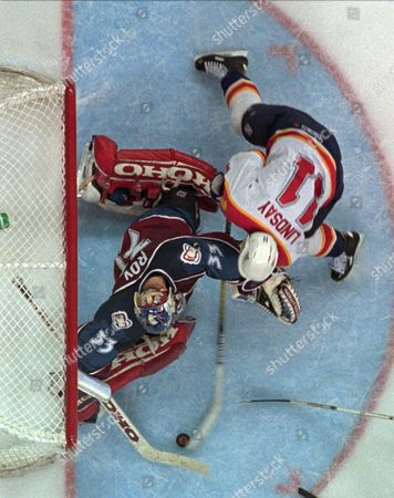 Stock Image of LINDSAY ROY Colorado Avalanche Patrick Roy (33) saves a goal off the stick of Florida Panthers Bill Lindsay (11) during the first overtime, in Miami. The Avalanche defeated the Panthers 1-0 in triple overtime