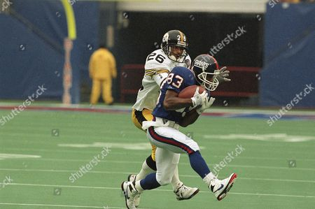 New York Giants wide receiver Arthur Marshall (83) pulls in a pass in front of Pittsburgh Steelers cornerback Rod Woodson (26) during the first quarter action, at Giants Stadium in East Rutherford, N.J
