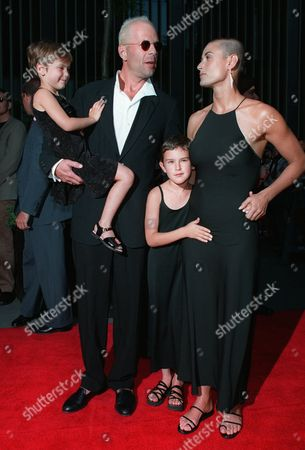 "MOORE WILLIS Actress Demi Moore, right, accompanied by husband Bruce Willis, and their children, Scout, left, and Rumer, center, arrive at the premiere of ""Striptease,"" at the Ziegfeld Theatre in New York . Moore stars in the film which was directed by Andrew Bergman and produced by Mike Lobell"