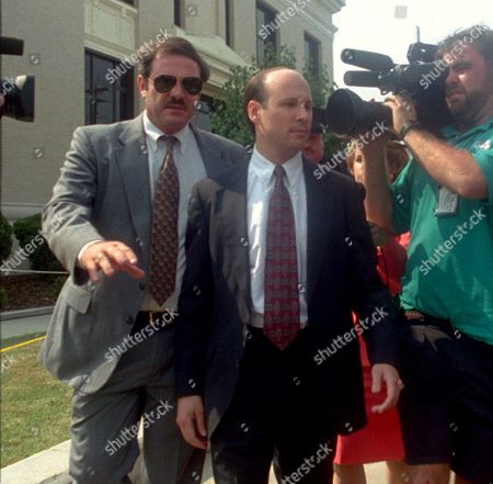 FINDLAY Tom Findlay, center, the former boyfriend of Susan Smith, leaves the Union County Courthouse, after testifying at her trial. Findlay testified that a few days before Smith drowned her sons, he wrote her that the boys were one reason their relationship could not continue