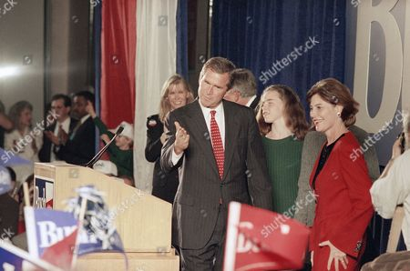 George W. Bush signals to supporters with daughter Barbara, second from left, and wife Laura, in Austin, Texas. Bush beat Democrat Ann Richards