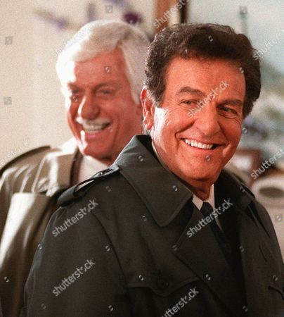 """CONNOR VAN DYKE Actor Mike Connors, who starred in television detective show """"Mannix,"""" flashes a smile for crew members after filming a scene with Dick Van Dyke, background, for an episode of the television show """"Diagnosis Murder,"""", in Los Angeles. The show will center around an unsolved mystery from """"Mannix,"""" with Connors returning to his old role as the title character"""