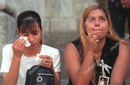ESCOBALES VEGA Lissette Escobales, left, wipes tears from her face as Quetcy Vega looks up before the start of the memorial mass at St. Patrick's Cathedral in New York, . Quetcy and Lissette lost their aunt Elsie Lopez and cousin Chelsea Lopez in the crash of TWA Flight 800. Flight 800 exploded July 17, 1996 en route from New York to Paris