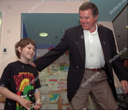 """PETERSON-TAKKI URICH Cancer patient Alex Peterson-Takki, 7, of Toronto, Canada, left, meets with actor Robert Urich, known for his role in the television show """"Spenser for Hire,"""" at the Dana-Farber Cancer Institute in Boston, . Urich is a survivor of synovial sarcoma, a rare form of cancer. He is in Boston to speak about his battle against cancer at """"Celebrating Life!"""", a 50th anniversary celebration with patients, families and staff reuniting at Dana-Farber on Saturday"""