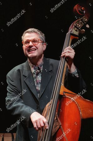 "Stock Image of BLUES 2--Jazz bassist Charlie Haden laughs with bandmates during soundcheck at the House of Blues in West Hollywood, Calif., before a concert by Quartet West. Haden and his band garnered two Grammy nominations this year for ""Now Is the Hour"