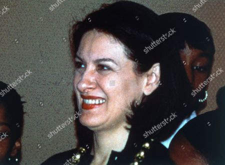 """French-Spanish jewelry designer Paloma Picasso celebrates with students of """"Learning through the Guggenheim Museum"""" children's program at the opening of an art exhibition of their work, at Tiffany and Co. in New York City, United States in 1995"""