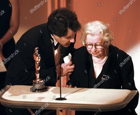 """Stock Photo of BLAIR GIES Jon Blair, who won the Oscar for the Best Documentary Feature """"Anne Frank Remembered,""""speaks with Miep Gies, who found the diary and brought it to the public at the 68th Annual Academy Awards in Los Angeles"""