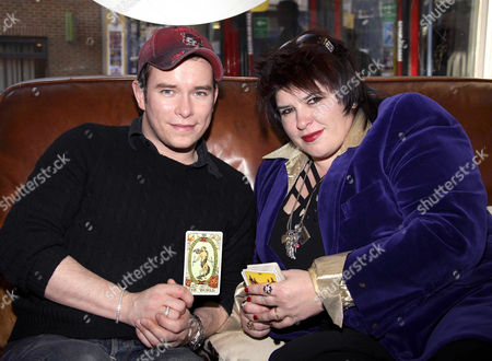 Stephen Gately and TV astrologer Michele Knight at MACS salon, London. He had a Tarot card reading done by Michele