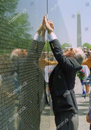 Ted Morris of Austin, Texas makes a rubbing of a name on the Vietnam Veterans Memorial in Washington, D.C., . April 30 marks the 20th anniversary of the end of the Vietnam war