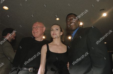 Actors Wesley Snipes, right, Diane Lane and Daniel Benzali pose for photographers while arriving for the industry screening of Warner Bros.? ?Murder at 1600,? in the Westwood area of Los Angeles on