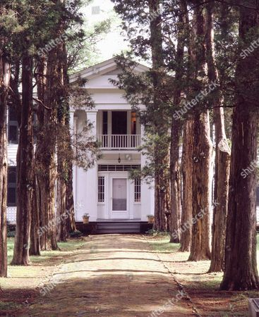 Stock Photo of FAULKNER Built by a pioneer settler in the 1840s and situated deep in a grove of oak and cedar trees, Rowan Oak, in Oxford, Miss., was purchased by Nobel Prize-winning author William Faulkner in 1930. It was his home until his death in 1962. The University of Mississippi purchased the house and its 31-acre grounds in 1972 from Faulkner's daughter, Jill Faulkner Summers. Every year over 11,000 people visit the antebellum home, which is both a National Historic Landmark and a National Literary Landmark