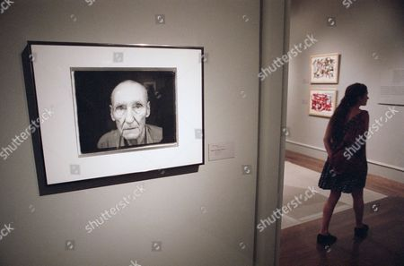 "Art photograph gallery A visitor to the ""Ports of Entry: William S. Burroughs and the Arts"" exhibition walks past a 1995 portrait of an aged Burroughs by photographer Annie Liebovitz, at the Los Angeles County Museum of Art on"