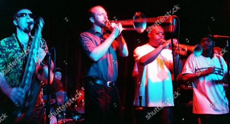 """DIRTY 22-24--Liquid Soul bandmembers, from left, Mars Williams, John Janowiak, Ron Haynes and """"The Dirty MF,"""" perform at Luna Park nightclub in West Hollywood, Calif. The 10-piece band also played in August at the prestigious JVC Jazz Festival in Newport, a first for an acid jazz group"""