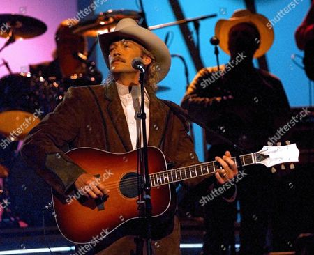 "ALAN JACKSON There's not much that's ""Little Bitty"" about 6-foot-4-inch country singer Alan Jackson. He's sold more than 18 million CDs and has 21 No. 1 hits. His recording of ""Little Bitty,"" a song written and previously released by Tom T. Hall, is Jackson's latest hit"