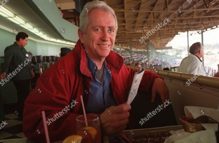 """DOWNEY Robert Downey, Sr. takes a break during a day at the horse races at Santa Anita Park in Arcadia, Calif., . Downey, an independent filmmaker, is feeling good these days about his new movie, """"Hugo Pool,"""" and his son Robert Downey, Jr., who is finishing a stay in a drug rehab program"""