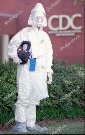 EBOLA GALLOWAY CDC Pat Galloway, a registered nurse and training assistant in the Office of Health and Safety at the Centers for Disease Control and Prevention in Atlanta, poses in a field protective suit and respirator, like ones researchers will use when investigating cases of Ebola virus infection in Zaire. A team of researchers from the CDC have joined with the World Health Orginization to investigate the virus outbreak in the African nation. The respirator consists of a battery powered, filtered intake, hose and hood that creates a positive air flow inside the hood blowing out holes in the chin area. It is the main line of defense researchers will have against infection