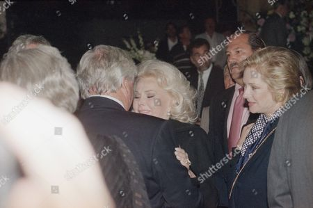 Zsa Zsa Gabor receives a tearful hug from friend Merv Griffin on Tuesday night, after a memorial service in Beverly Hills, Calif., for her sister actress Eva Gabor. Gabor died July 4, 1995, at a Los Angeles Hospital