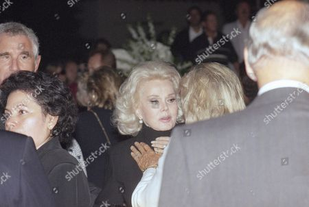 Zsa Zsa Gabor receives condolences from friends after a memorial service for her sister actress Eva Gabor, in Beverly Hills Calif. Gabor died July 4, 1995 at a hospital in Los Angeles