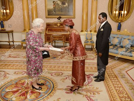 Stock Picture of Queen Elizabeth II, High Commissioner of Tanzania Dr Asha-Rose Migiro and husband Cleophas Migiro
