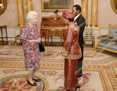 Queen Elizabeth II, High Commissioner of Tanzania Dr Asha-Rose Migiro and husband Cleophas Migiro