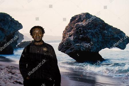 John Akomfrah with artwork Auto Da Fé