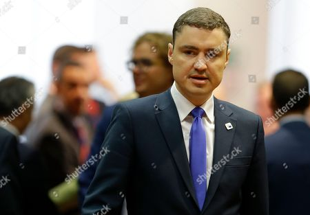 Estonian Prime Minister Taavi Roivas arrives just prior to the start of a round table session during the EU Summit in Brussels