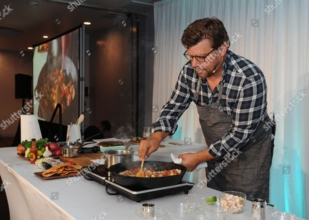 Chef Ben Ford conducts a cooking demo at the Reimagine MySelf? event hosted by Biogen, in Los Angeles