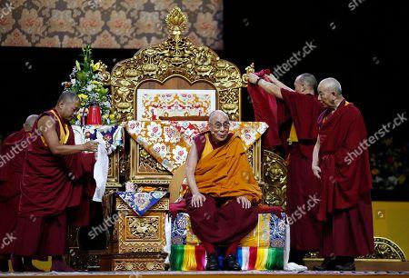 Tenzin Gyatso The Dalai Lama Tenzin Gyatso attends a fair, in Milan, Italy, . The Dalai Lama received honorary citizenship from the city of Milan