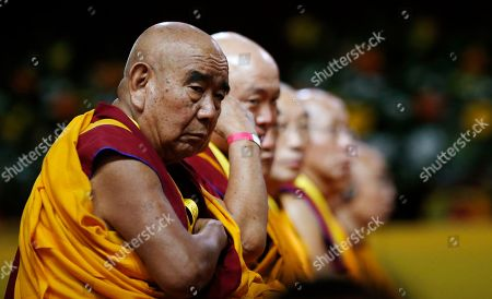 Buddhist monks attend a meeting with the Dalai Lama Tenzin Gyatso at Milan's Rho Fair, Italy, . The Dalai Lama received honorary citizenship from the city of Milan