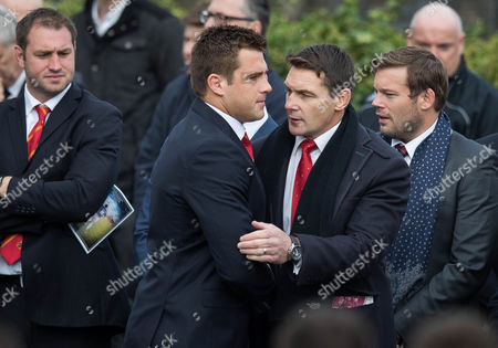 Stock Image of Munster's CJ Stander with former Munster and Ireland player David Wallace