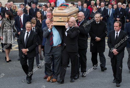 Mick Galway, Peter Clohessy, Keith Wood and John Hayes carry The coffin of Munster Rugby head coach Anthony Foley